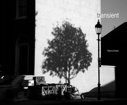 Photo-book Transient - b&w street international encounters. Traveling through light and space, contemplating time and flowing motion, finding myself in 'a location' and then experiencing the feeling of a 'dislocation'