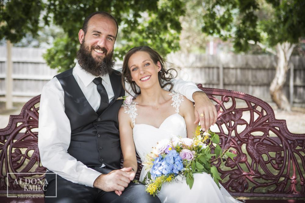 Sneak peek wedding photos  Natural Wedding Couple sitting on a bench