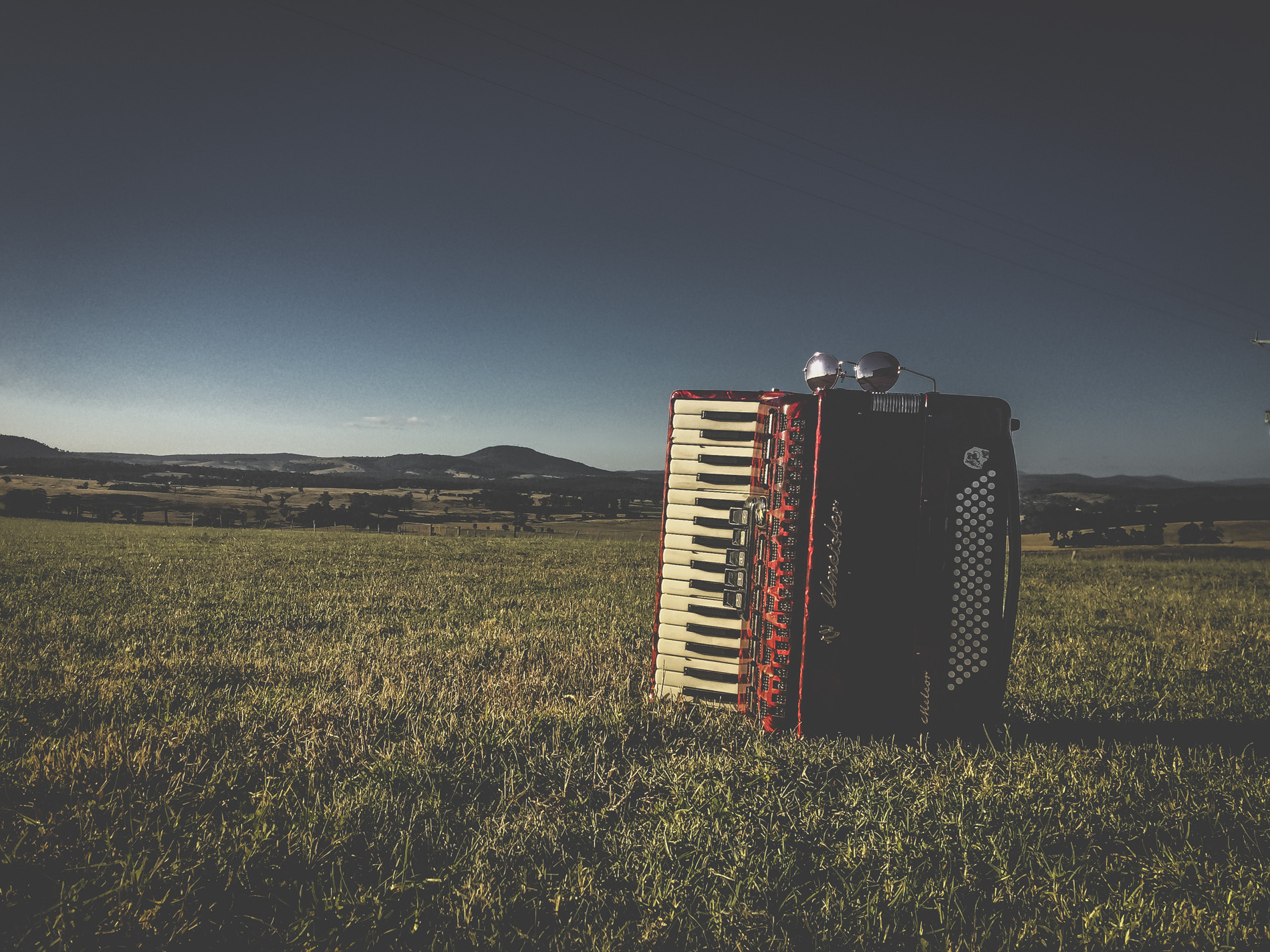 Czerwony Akordeon Red piano accordion in the landscape Aldona Kmiec Polish Art Photographer