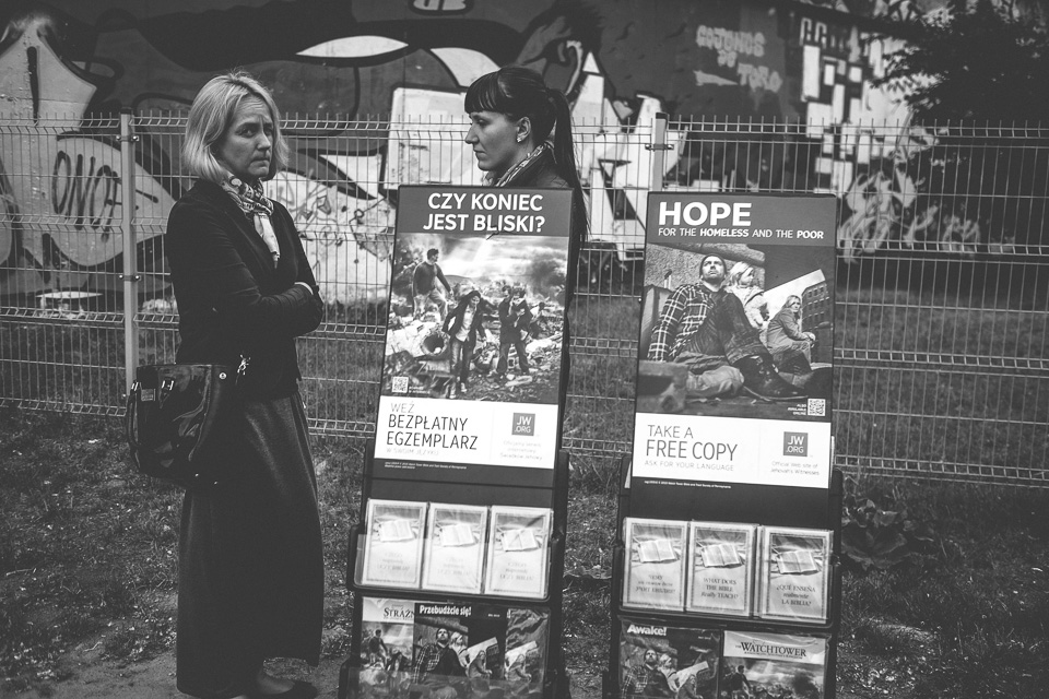 Street smart Jehovah's Witnesses believers swap doorstepping for standing outside train stations